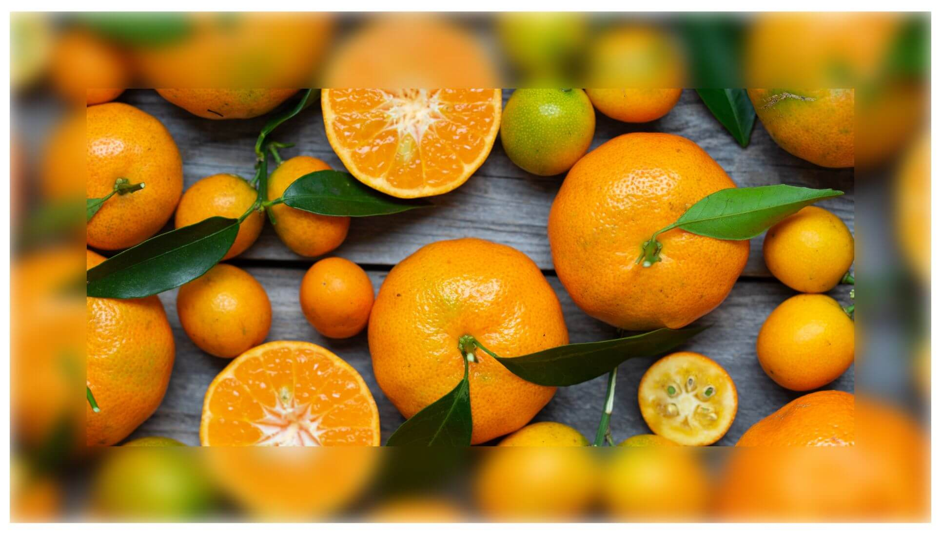 Screenshot of an element with a background image that shows oranges on a wooden table. The border of this element is blurred.