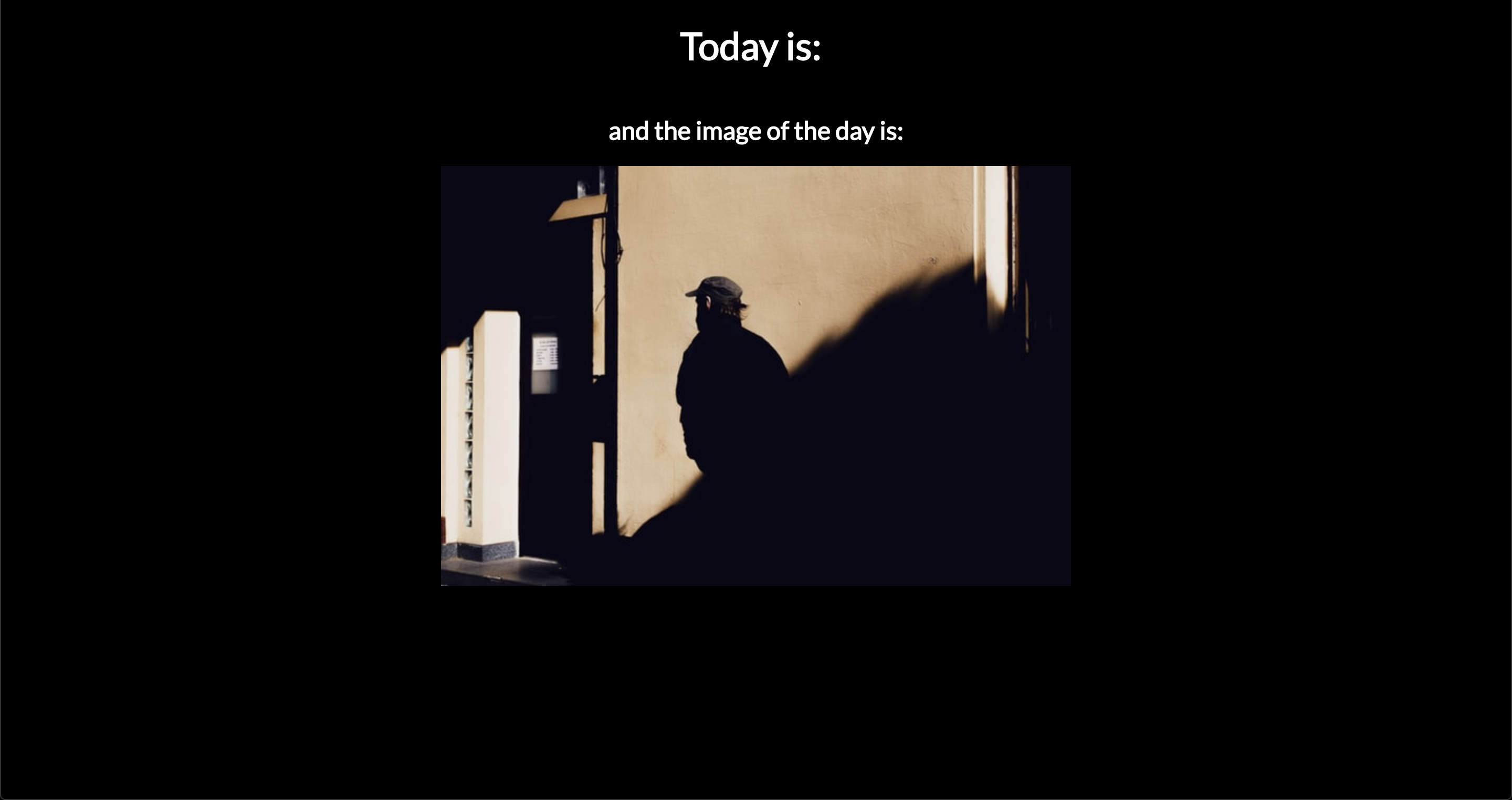 Webpage with black background, a heading and an image